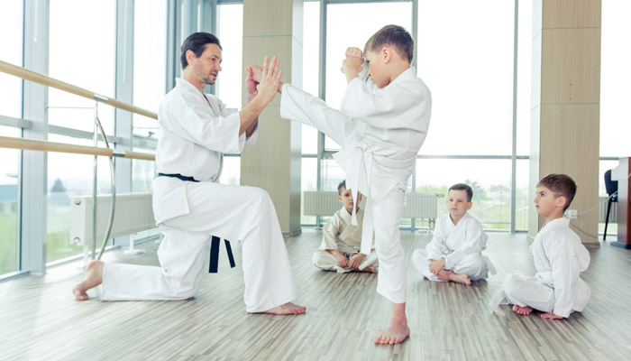 boy learning how to martial arts kick
