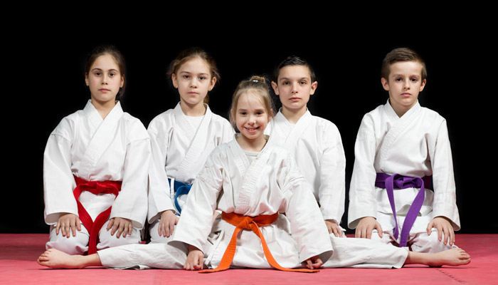 martial arts child students serious faces