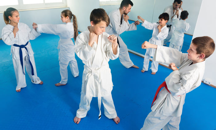 martial arts students practicing punch moves